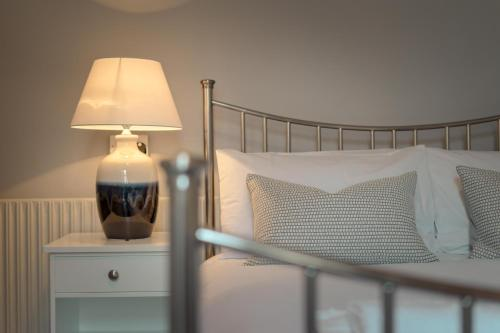 A bed or beds in a room at Anabelle's Guest House