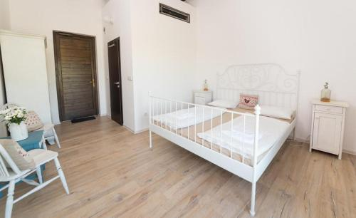 A bed or beds in a room at Thetis Birtok