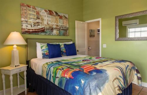 A bed or beds in a room at Caribbean House, No Resort Fees