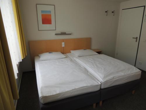 Ein Bett oder Betten in einem Zimmer der Unterkunft CVJM Düsseldorf Hotel & Tagung