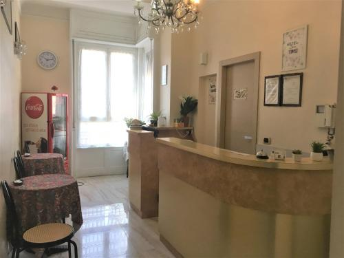 The lobby or reception area at Hotel San Tomaso