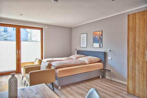 A bed or beds in a room at City Apparte Exklusiv