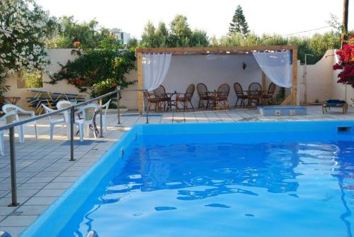 The swimming pool at or near Hotel Handakas