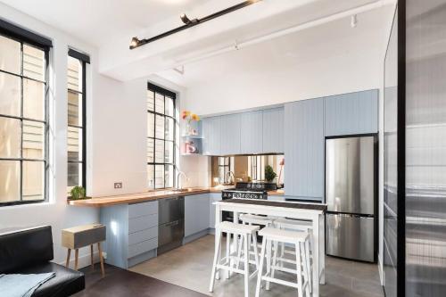 A kitchen or kitchenette at Spacious Designer Warehouse Melbourne CBD Apartment