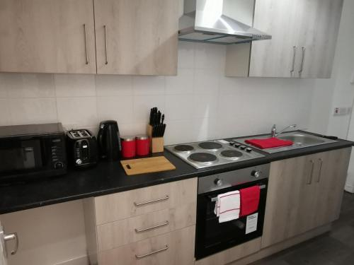 A kitchen or kitchenette at CR Anfield Apartments