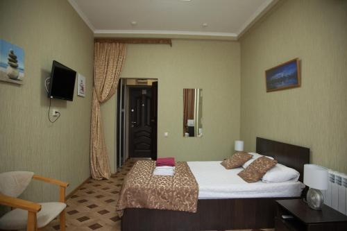 Кровать или кровати в номере Apartment Svetlana Kurortnyi