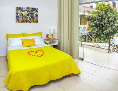 A bed or beds in a room at El Huerto Hostel