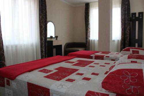 A bed or beds in a room at Guest House Anastasia