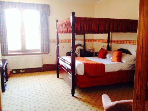A bed or beds in a room at Purbeck House Hotel & Louisa Lodge