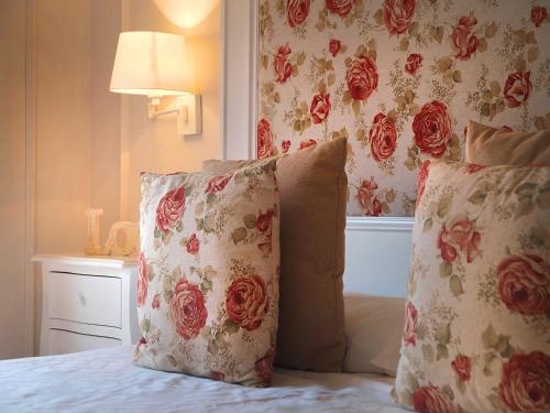 A bed or beds in a room at Hotel Santa Maria de Alquezar