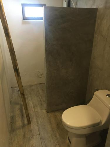A bathroom at Beachub - Coworking Village