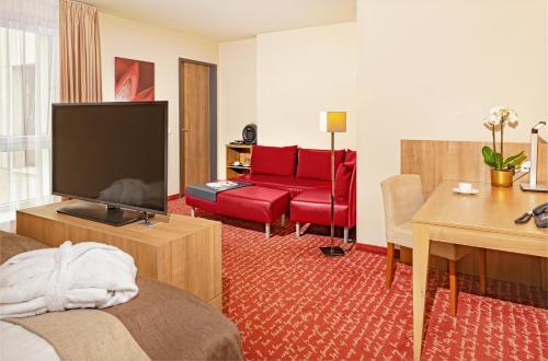 Телевизор и/или развлекательный центр в Welcome Hotel Darmstadt