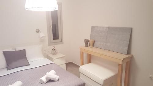 Ένα ή περισσότερα κρεβάτια σε δωμάτιο στο Akrotiri Skyros