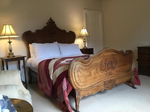 A bed or beds in a room at Clow Beck House