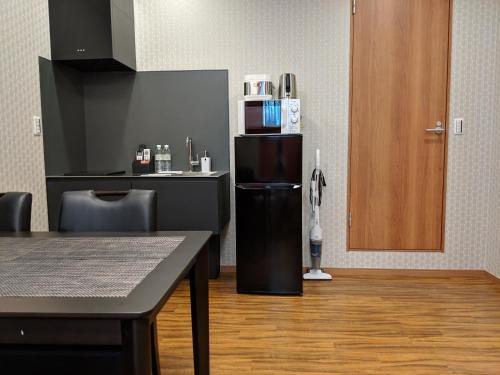 A kitchen or kitchenette at SAKURA GARDEN VILLA