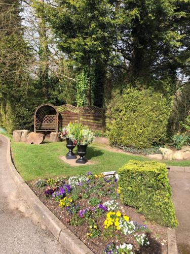 A garden outside De Courceys Cottages