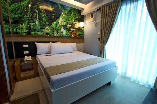 A bed or beds in a room at Eurotel Boracay