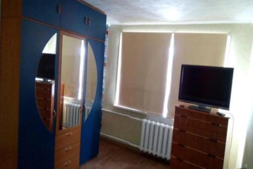 Телевизор и/или развлекательный центр в Apartment on Leninskiy 27