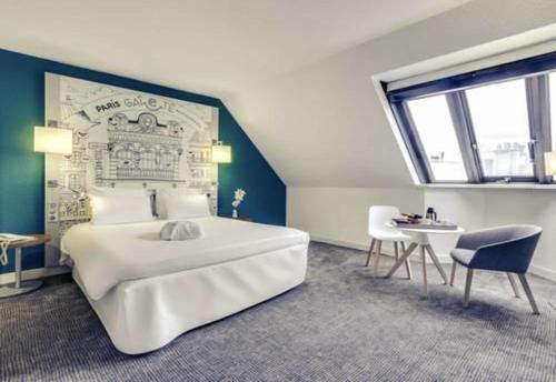Un ou plusieurs lits dans un hébergement de l'établissement Mercure Paris Gare Montparnasse