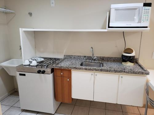 A kitchen or kitchenette at Hotel Costa Victória