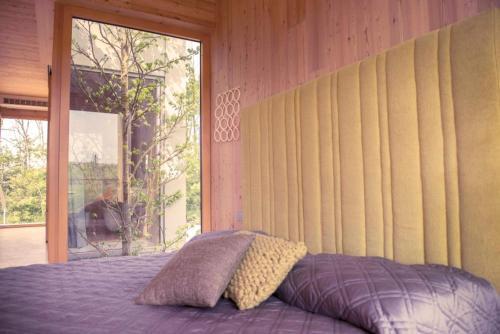 Letto o letti in una camera di Eco Bio Agriturismo La Bella Vite - Camere Con Vigna