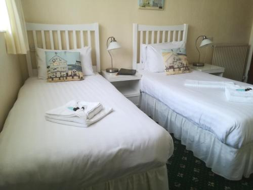 A bed or beds in a room at Eastmount Hall Hotel