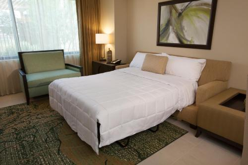 A bed or beds in a room at The Berkley, Las Vegas