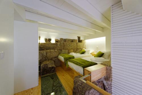 Uma área de estar em Guimarães Studios Lounge