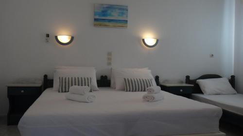 Ένα ή περισσότερα κρεβάτια σε δωμάτιο στο Blue & Sea Studios