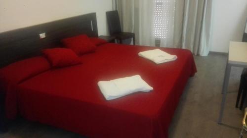 Un pat sau paturi într-o cameră la Hotel Ponte Bianco