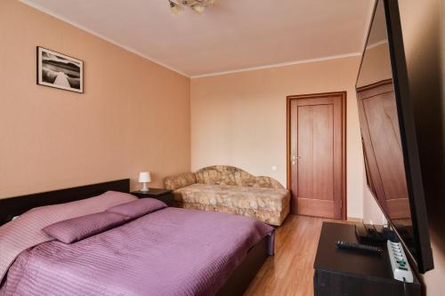 Кровать или кровати в номере Апартаменты на Есенина