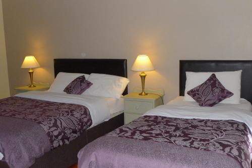A bed or beds in a room at Quay House