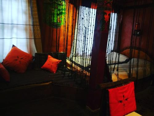 A bed or beds in a room at Shambhala Palace Hotel