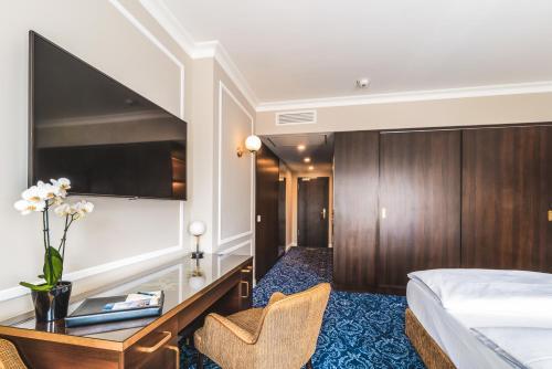 Et tv og/eller underholdning på Hotel Suitess