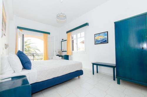 Ένα ή περισσότερα κρεβάτια σε δωμάτιο στο Natural Blue Green Apartment