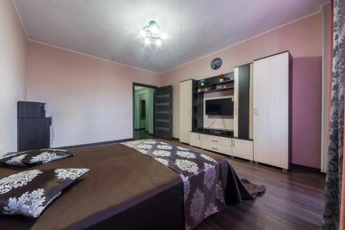 Кровать или кровати в номере Apartment Soft near Grinvich
