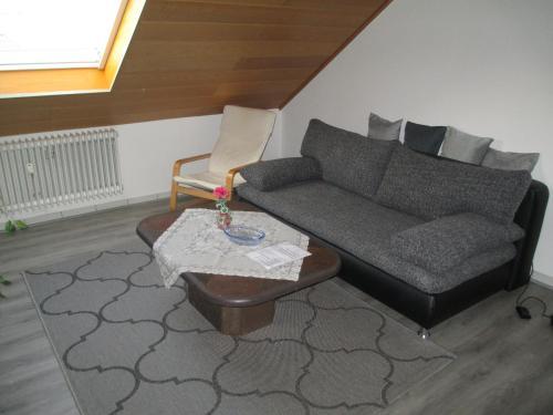 A seating area at Ferienwohnungen Hehner