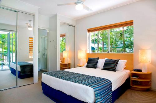A bed or beds in a room at Verano Resort Noosa