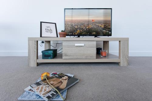 A television and/or entertainment center at Stylish Aptm @ SouthYarra
