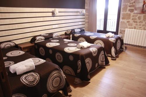 A bed or beds in a room at La Casa de Beli