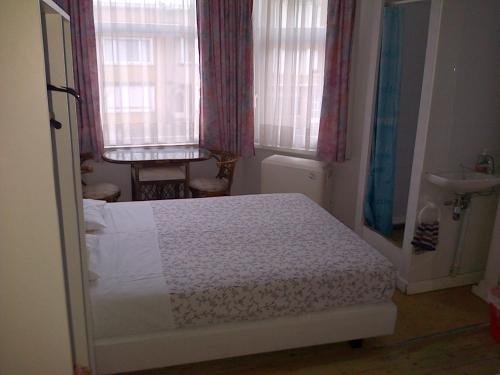 Ein Bett oder Betten in einem Zimmer der Unterkunft Budget Logies Grenadine