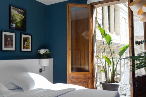 Cama o camas de una habitación en Hostal Sol y K