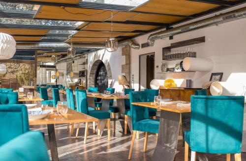 A restaurant or other place to eat at Box Art Hotel - La Torre