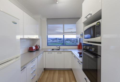 A kitchen or kitchenette at St Tropez Unit 37 - The Entrance, NSW