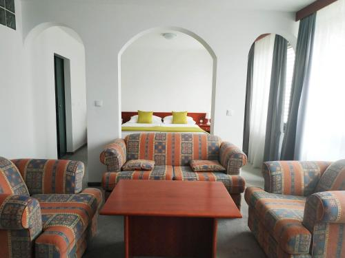 A bed or beds in a room at ibis Styles Maribor City Center