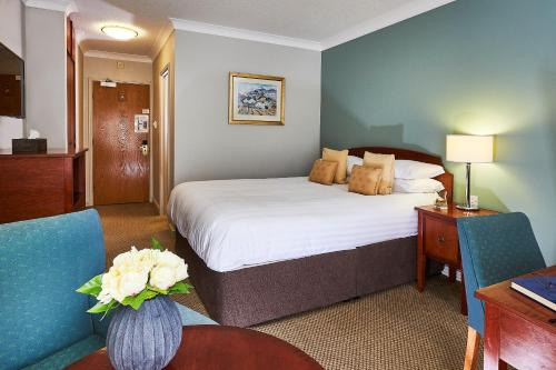 A bed or beds in a room at Sedgebrook Hall