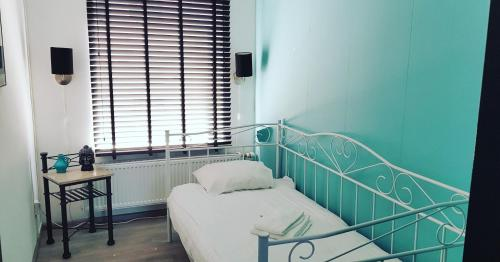A bed or beds in a room at Apartment Zilt Aan Zee