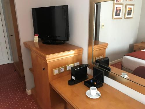A television and/or entertainment center at Lakeside International Hotel