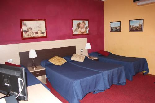 A bed or beds in a room at Hotel San Lorenzo