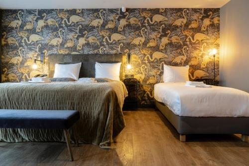 A bed or beds in a room at Boutique Suites Lisse - Schiphol